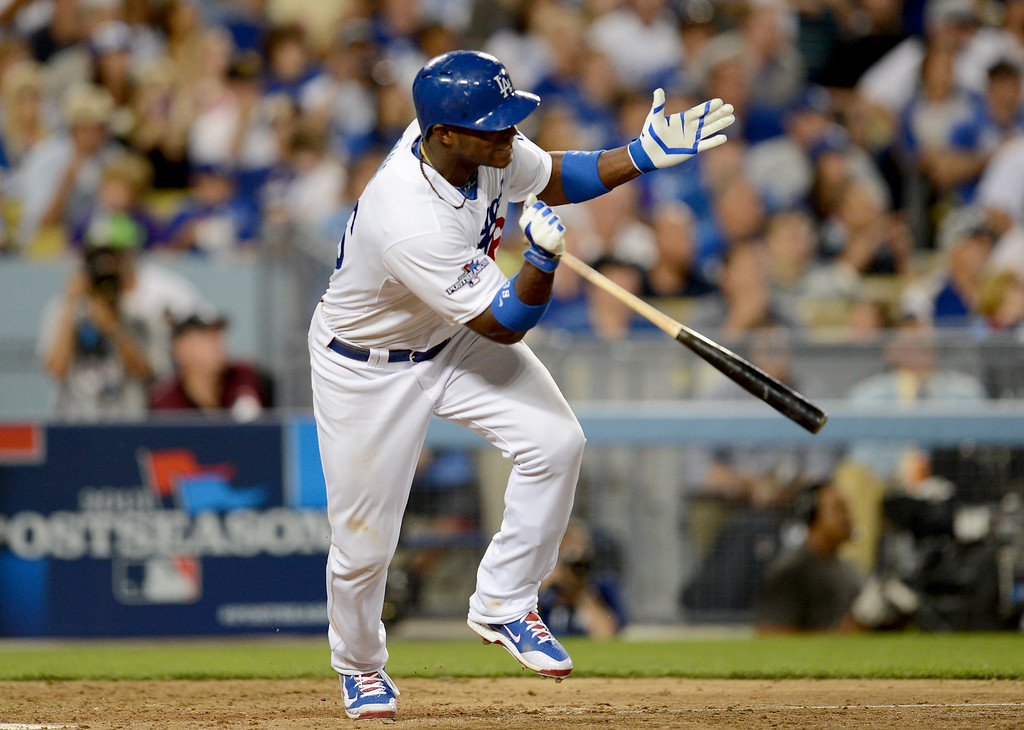 . Los Angeles Dodgers\' Yasiel Puig makes a single in the fourth inning of game 3 of the NLDS at Dodger Stadium Sunday, October 6, 2013. (Photo by Hans Gutknecht/Los Angeles Daily News)