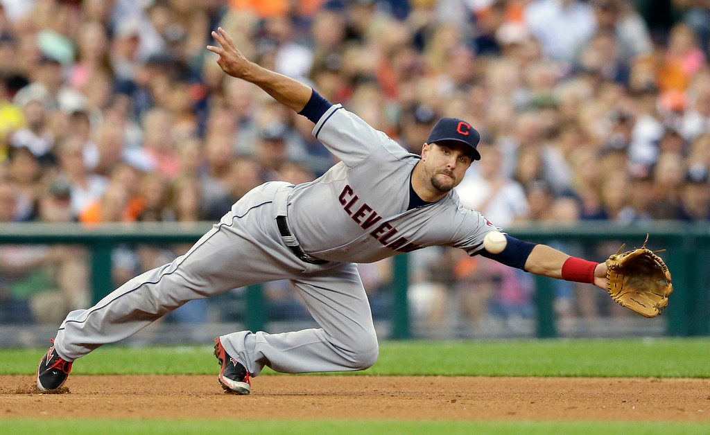 . Cleveland Indians third baseman Lonnie Chisenhall dives but misses the single by Detroit Tigers\' J.D. Martinez during the fourth inning of a baseball game in Detroit, Friday, July 18, 2014. (AP Photo/Carlos Osorio)