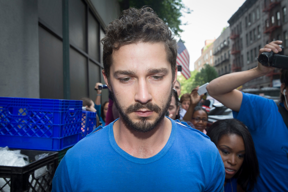 """. Actor Shia LaBeouf is followed by media after leaving Midtown Community Court following his arrest the previous day for yelling obscenities at the Broadway show \""""Cabaret,\"""" Friday, June 27, 2014, in New York. The 28-year-old star of the \""""Transformers\"""" franchise faces charges that include disorderly conduct and criminal trespass.  (AP Photo/John Minchillo)"""