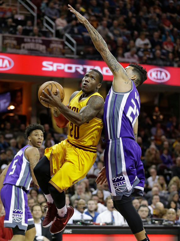 . Cleveland Cavaliers\' Kay Felder (20) drives against Sacramento Kings\' Matt Barnes (22) during the second half of an NBA basketball game, Wednesday, Jan. 25, 2017, in Cleveland. The Kings won 116-112 in overtime. (AP Photo/Tony Dejak)