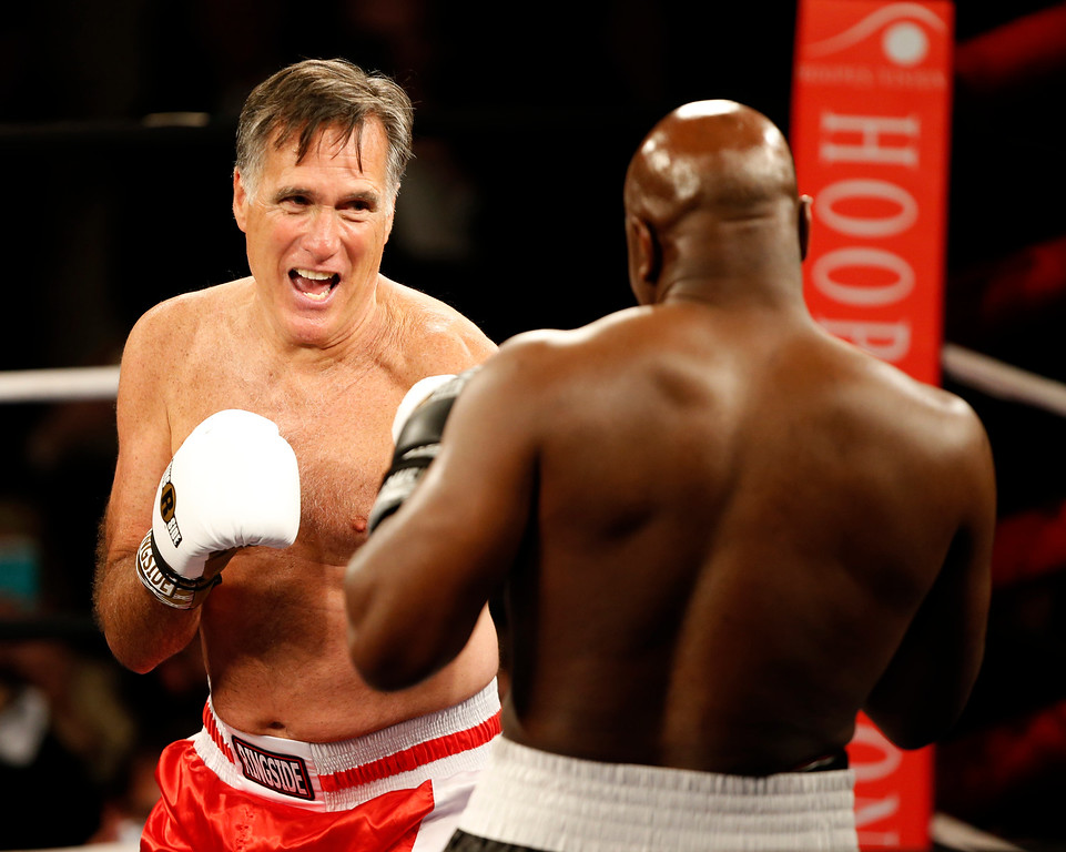 ". Mitt Romney and Evander Holyfield fight in a charity boxing event on May 15, 2015 in Salt Lake City, Utah. The event was held to raise money for  ""Charity Vision\"" a charity that aims to restore sight to the blind and visually impaired. (Photo by George Frey/Getty Images)"