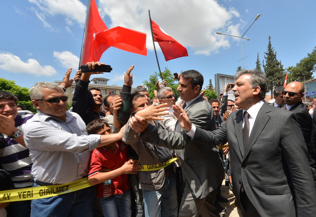 . This picture released by the Turkish Presidential Press office shows Turkish President Abdullah Gul (R) greeting people as he visits one of the two blast sites, which resulted in the deaths of 51 people over the weekend, in the town of Reyhanli, in Hatay province near the Turkish-Syrian border, on May 16, 2013. AFP PHOTO/ TURKISH PRESIDENCY/Ayhan Arfat/AFP/Getty Images