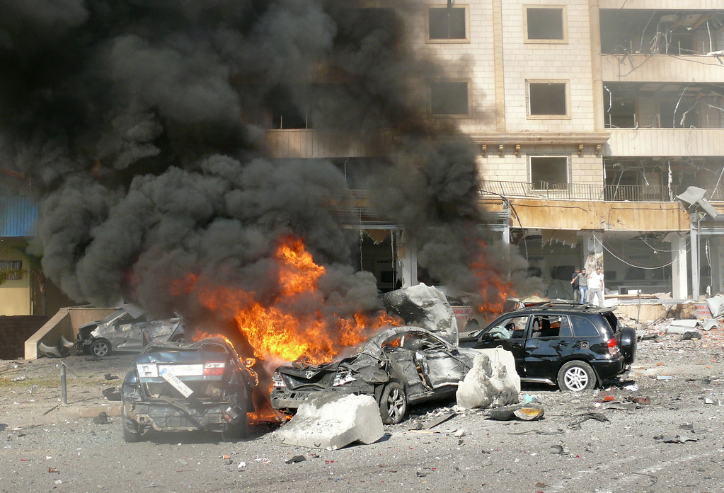 . Flames rise from the wreckage of cars following a bomb explosion in a outhern suburb of the capital Beirut on February 19, 2014. AFP PHOTO / STRSTR/AFP/Getty Images