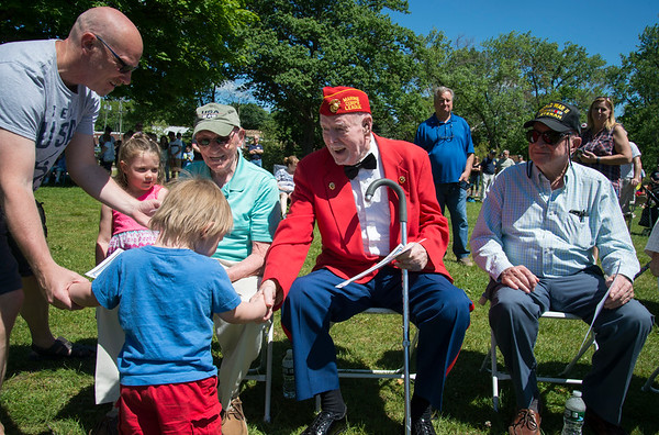 05/27/19 Wesley Bunnell | Staff Bristol held Memorial Day ceremonies on Monday morning ending with a ceremony which presented World War II veterans with All Heart Awards from the city. Veteran and award recipient George Burns shakes hands with Cyrus McNamara, age 1, the great grandson of fellow veteran and award recipient Antonio Benvenuto, seated L.