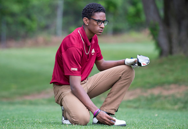 05/29/19 Wesley Bunnell | Staff New Britain golf competed along with Berlin and Goodwin Tech in the Stan Pisk Memorial Golf Tournament on Wednesday afternoon at Stanley Golf Course. New Britain's Dylan Washington looks over his tee shot.