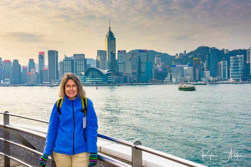 Mary poses along the Tsim Sha Tsui Waterfront Promenade in Hong Kong.