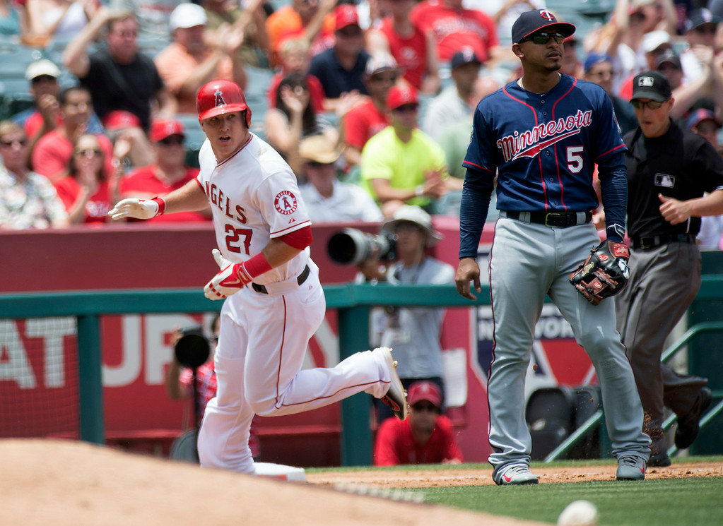 . Angels\'s Mike Trout scores on a hit by Albert Pujols (not pictured) as they play the Minnesota Twins at Angel Stadium in Anaheim on Thursday June 26, 2014. The Angels defeated the Minnesota Twins 6-4. (Photo by Keith Durflinger/Whittier Daily News)
