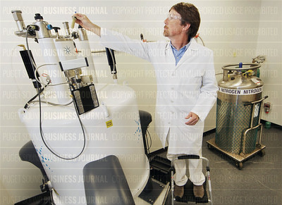 Omeros scientist analyzes a chemistry sample in the company's nuclear magnetic resonance laboratory
