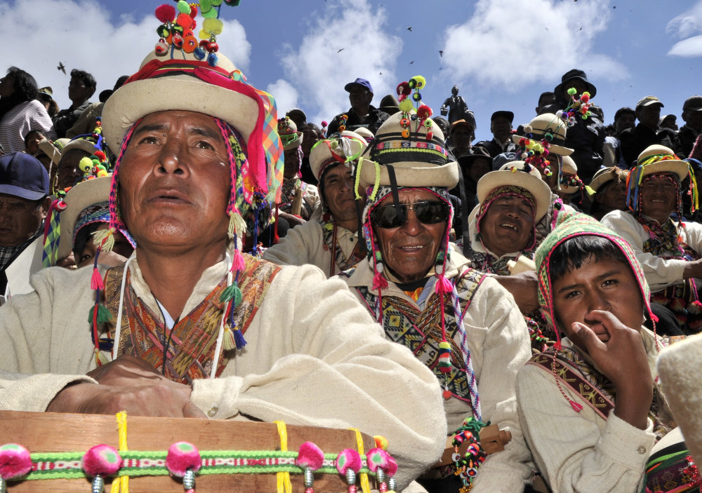 Description of . Aymara indigenous peasants attend celebrations for the third anniversary of the Plurinational State of Bolivia outside Quemado palace in La Paz, on January 22, 2013. AIZAR RALDES/AFP/Getty Images