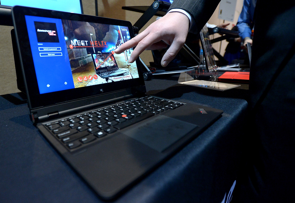 . Lenovo introduces their new tablet/laptop Thinkpad Helix during the opening event \'\'CES Unveiled\'\'  during the  International Consumer Electronics Show (CES) in Mandalay Bay Hotel resort on January 06, 2013 in Las Vegas, Nevada. (JOE KLAMAR/AFP/Getty Images)