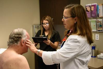 Dr Fleischi doing procedure on patient