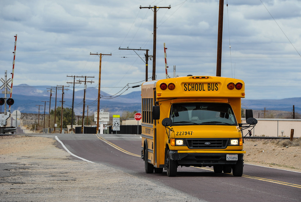 . A school bus drives past Hinkley Elementary/Middle School in Hinkley, Calif. on Thursday, March 7, 2013. The Barstow Unified School District voted to close the town\'s only school due to declining enrollment , which once hosted 600 students and now has 263 students. (Rachel Luna / San Bernardino Sun)