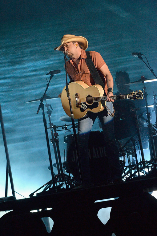 . NASHVILLE, TN - NOVEMBER 06:  Jason Aldean performs onstage during the 47th annual CMA awards at the Bridgestone Arena on November 6, 2013 in Nashville, United States.  (Photo by Rick Diamond/Getty Images)