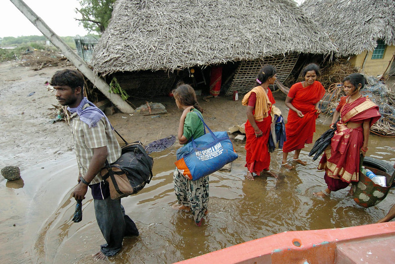 . People leave the devastated Karmavadi village with their belongings in the Nagapattinam district, some 350 km south of Madras, 27 December 2004, after tidal waves hit the region.  The death toll in southern India from tidal waves that battered much of Asia crossed 6,800 Monday with thousands still missing, officials said. The official count of 6,823 dead included some 3,000 in the Andaman and Nicobar Islands, close to the epicenter of the Indonesian earthquake that caused the tsunamis, and another 3,600 in the southern Indian state of Tamil Nadu and the former French colony of Pondicherry. PRAKASH SINGH/AFP/Getty Images
