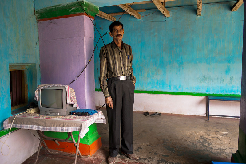 Chattisgarh, India, February 2015:   Hari Hara Prasad Patel , an ayurvedic doctor poses for a portrait at his home. His ancestral home is part of the area proposed for expansion of Gare Palma coal fields in Raigarh district.   Photographs for a story on land allocation for coal mines in Chattisgarh.  Modi's new government in the centre has relaxed the environmental regulations so the land can be allocated to both public and private sector companies easily.   Photo by Sami Siva for Al Jazeera America.