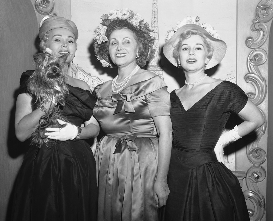 . Glamorous Gabor Sisters, Zsa Zsa, left, and Eva, right, flank their mother, Jolie Gabor, as they give a preview of the bonnets they\'ll be wearing on Easter.   Preview was in the costume jewelery shop of Mama Gabor in New York on March 30, 1966.  (AP Photo/Matty Zimmerman)