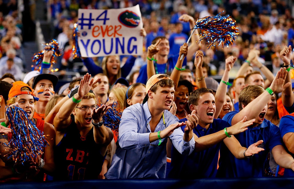 . ARLINGTON, TX - APRIL 05: Florida Gators fans cheer during the NCAA Men\'s Final Four Semifinal against the Connecticut Huskies at AT&T Stadium on April 5, 2014 in Arlington, Texas.  (Photo by Tom Pennington/Getty Images)