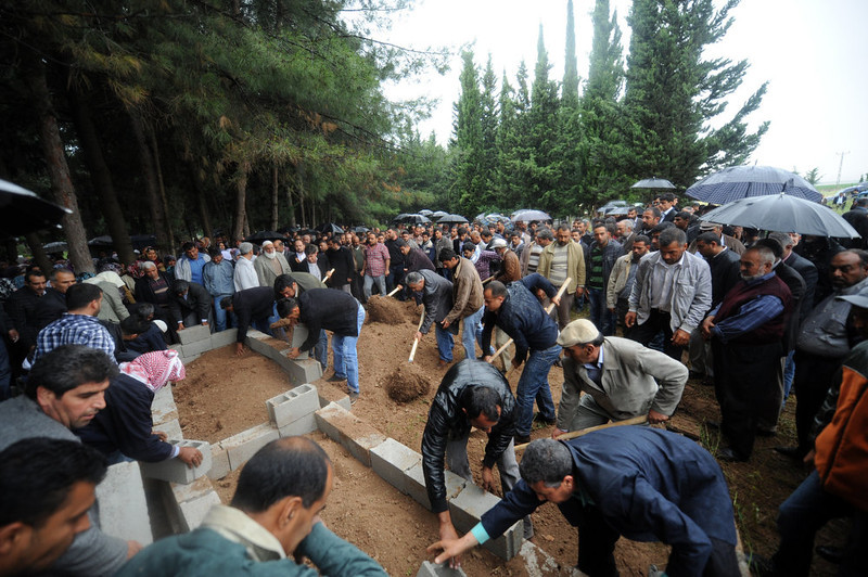 . Local relatives mourn on May 12, 2013 at the graves of victims of a car bomb which went off on May 11 at Reyhanli in Hatay just a few kilometers from the main border crossing into Syria. Turkey was reeling from twin car bomb attacks which left at least 43 people dead in a town near the Syrian border, with Ankara blaming pro-Damascus groups and vowing to bring the perpetrators to justice. A Syrian minister denied on May 12 accusations that Damascus was behind a bomb attack in a Turkish town that left dozens dead, a day after Ankara blamed supporters of President Bashar al-Assad for the blasts.   BULENT KILIC/AFP/Getty Images