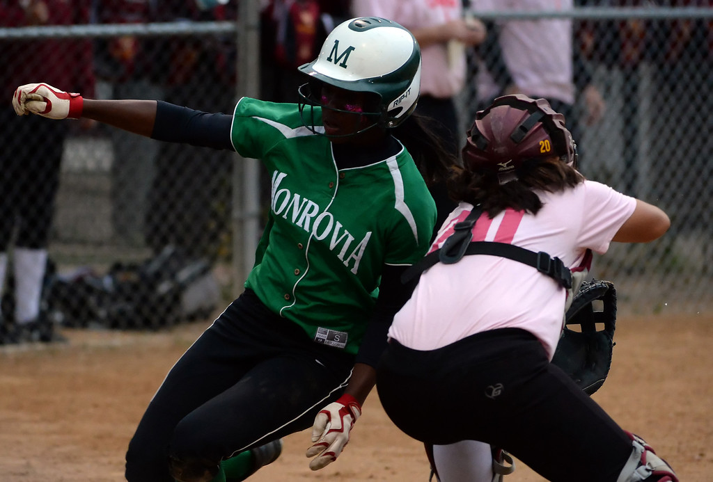 . Monrovia\'s Elise McCarthy scores past La Canada catcher Olivia Lam (20) in the first inning of a prep softball game at La Canada High School in La Canada, Calif., on Friday, April 25, 2014.  (Keith Birmingham Pasadena Star-News)