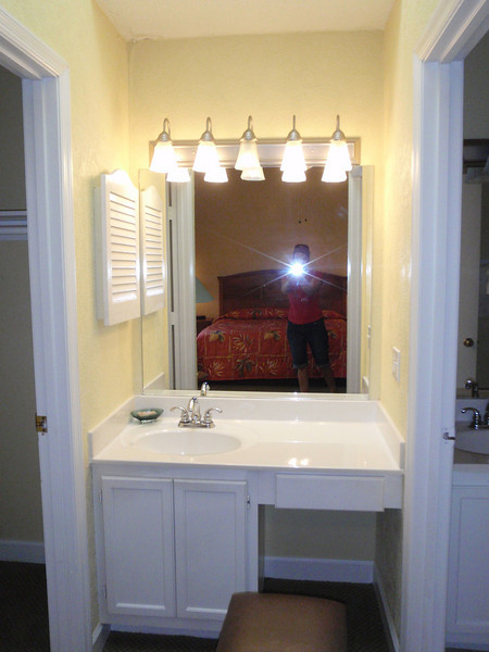 Me, lol, taking a pic of the makeup area in the Master Suite.