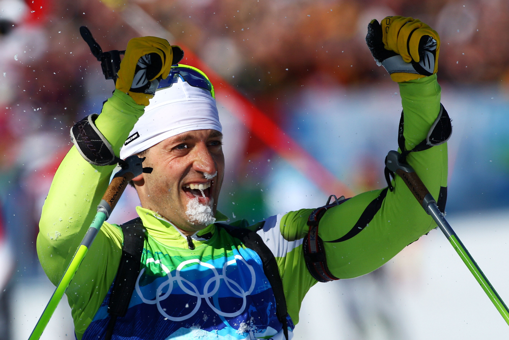 . Pavol Hurajt of Slovakia celebrates crossing the line to win bronze in the men\'s biathlon 15 km mass start on day 10 of the 2010 Vancouver Winter Olympics at Whistler Olympic Park Cross-Country Stadium on February 21, 2010 in Whistler, Canada.  (Photo by Alexander Hassenstein/Bongarts/Getty Images)