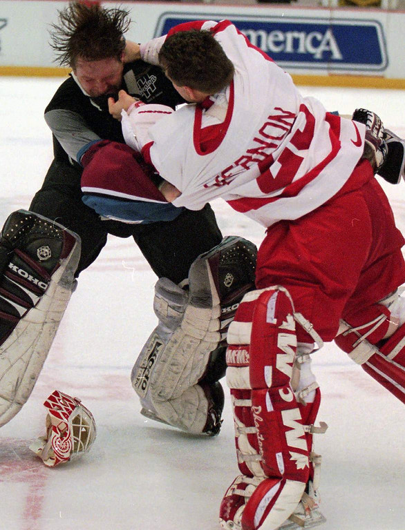. Colorado Avalanche goaltender Patrick Roy, left, takes a punch from Detroit Red Wings\' goaltender Mike Vernon during a first period brawl in Detroit in March of 1997.(AP Photo/Tom Pidgeon)