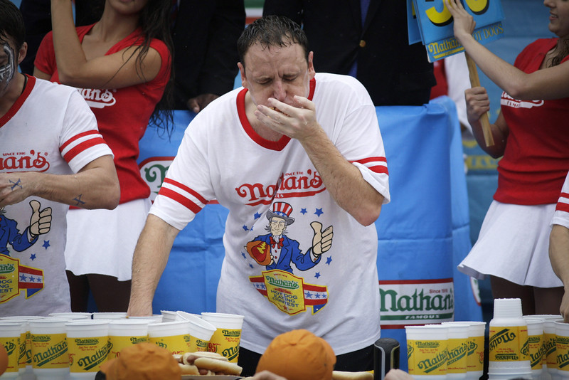 . Joey Chestnut competes in the 98th annual Nathan\'s Famous Hot Dog Eating Contest at Coney Island on July 4, 2014 in the Brooklyn borough of New York City.  Chesnut won his eighth straight Nathan\'s Hot Dog Eating Contest with 61 hot dogs. (Photo by Kena Betancur/Getty Images)
