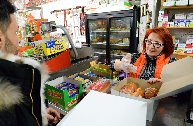 02/28/19  Wesley Bunnell | Staff  New Britain Flower Shop owner Nick Erlacher is waited on by Zieleniak Deli co owner Beata Rulka as he purchases a box of paczki on Fat Thursday.