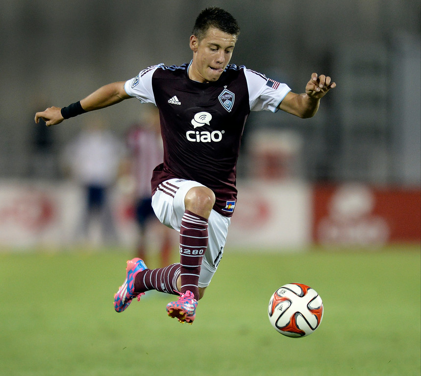 . Colorado midfielder Dillon Serna took a pass in the second half as the Colorado Rapids took on Chivas USA at Dick\'s Sporting Goods Park on Friday, July 25, 2014, in Commerce City, Colorado.  The Rapids won, 3-0. Photo by Karl Gehring/The Denver Post