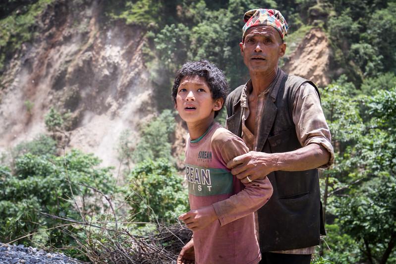 Father tries to protect his son from the incoming landslides during the important aftershock of May 12th in Nepal. Organization: CECI Nepal Sindhupalchok, Nepal. May 2015. --------- Un père tente de protéger son fils des glissements de terrain lors de l'importante réplique du 12 mai au Népal. Organisme: CECI Nepal Sindhupalchok, Népal. Mai 2015.