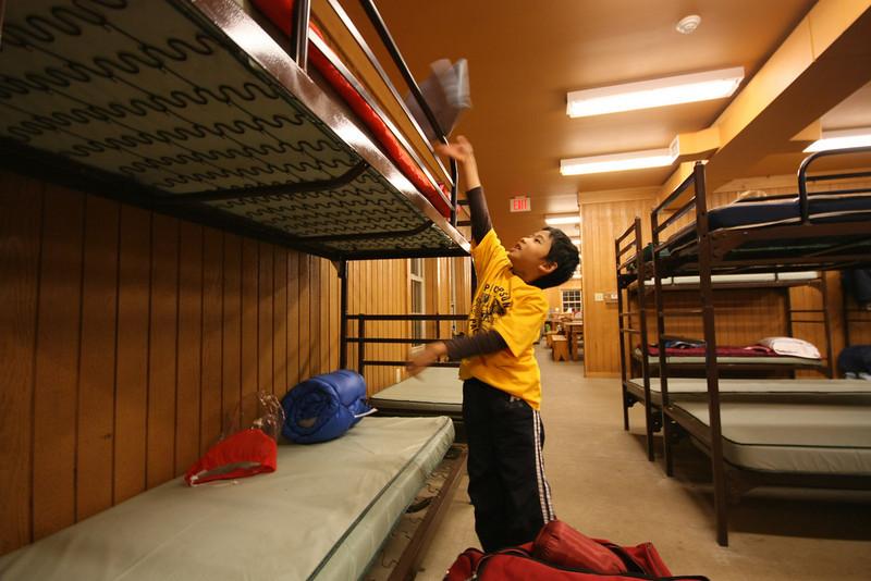 Brandon picks his spot on the top bunk