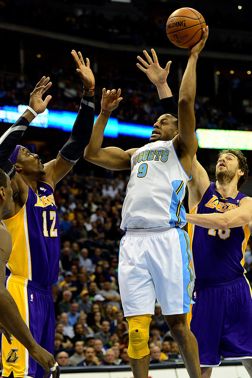 . Denver Nuggets shooting guard Andre Iguodala (9) takes the ball up against Los Angeles Lakers center Dwight Howard (12) and power forward Pau Gasol (16) during the first half at the Pepsi Center on Wednesday, December 26, 2012. AAron Ontiveroz, The Denver Post