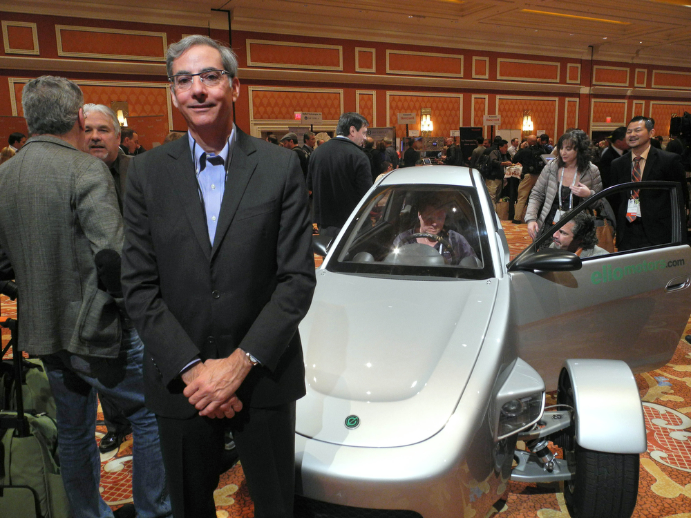Description of . Paul Elio, founder and CEO of Elio Motors poses in front of a prototype of three-wheeled car on display at the at the Showstoppers startup showcase on the sidelines of the 2014 Consumer Electronics Show(CES) January 9, 2014 in Las Vegas, Nevada. The sleek three-wheeled car looks futuristic, but, its creator acknowledges, it has no new technology. What makes the Elio Motors vehicle unique is its ultra-high fuel economy, and an ultra-low price tag: $6,800 USD. The vehicle promises to deliver as much as 84 miles (134 kilometers) per gallon (3.8 liters) of gasoline for highway driving. It accelerates as quickly as many cars on the road -- to 100 miles (160 kilometers) per hour in 9.6 seconds, according to the company. Urban fuel economy is estimated at 49 miles per gallon. AFP PHOTO / Rob LEVERRob LEVER/AFP/Getty Images