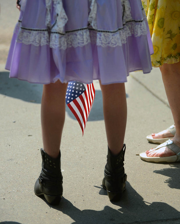 . A marcher waits for the start of the St. Anthony Park Fourth of July parade. (Pioneer Press: Chris Polydoroff)
