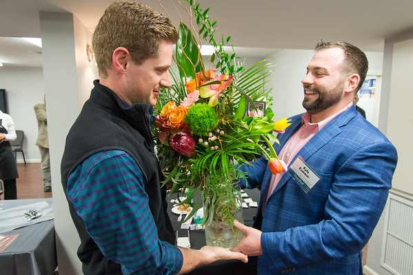04/09/19 Wesley Bunnell | Staff New Britain Memorial - Sagariino Funeral Home hosted an after hours event on Tuesday evening for the New Britain Chamber of Commerce members. Eric Amodio from Amodio & Co. Real Estate wins a raffle prize from New Britain Flower Shop which is presented to him by New Britain Chamber Interim President Kyle Kummer.