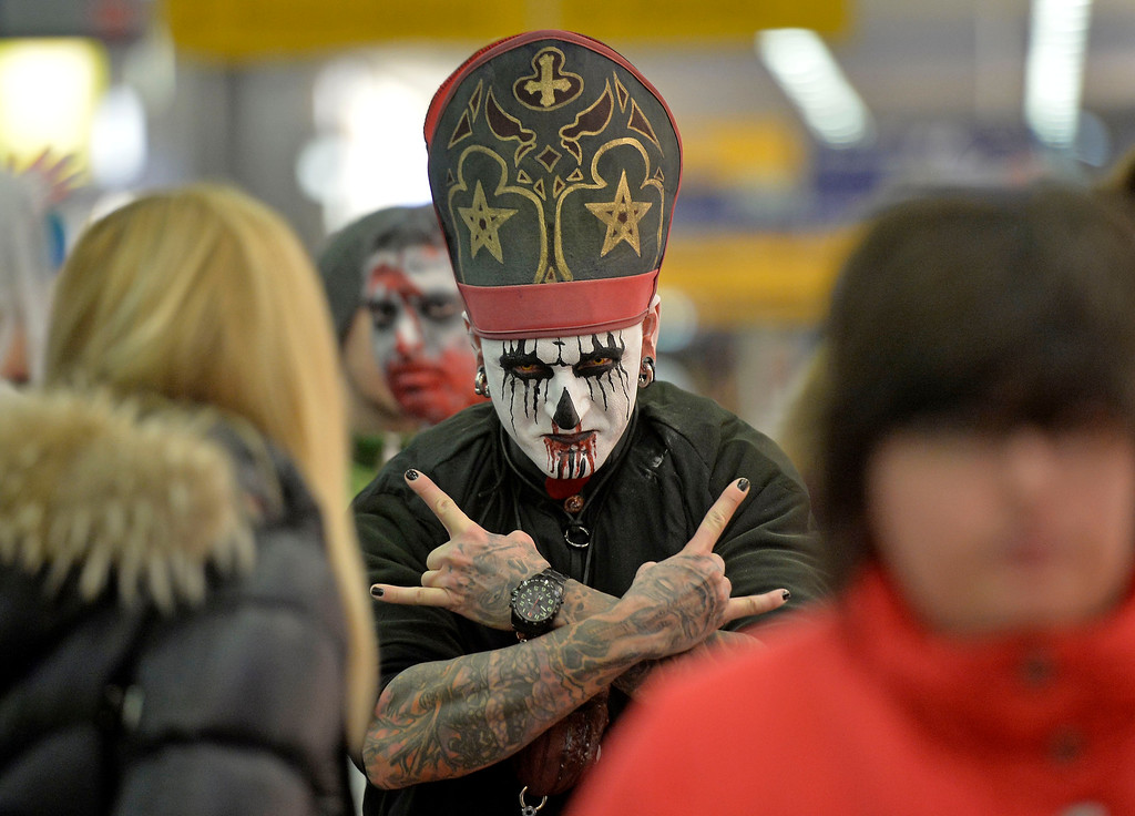 . A man dressed as a zombie gestures in the train station at the city center of Essen, western Germany, Thursday, Oct. 31, 2013. The \'zombie walk\' with around 1000 horror fans became a tradition in the city on Halloween. (AP Photo/Martin Meissner)