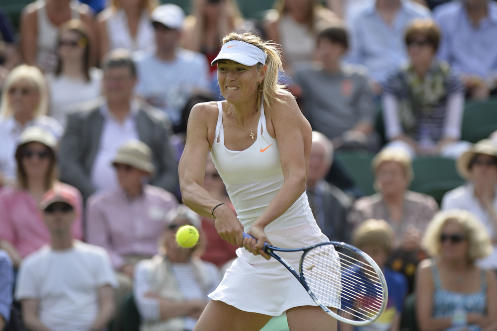 . Russia\'s Maria Sharapova returns against Portugal\'s Michelle Larcher De Brito during her second round women\'s singles match against on day three of the 2013 Wimbledon Championships tennis tournament at the All England Club in Wimbledon, southwest London, on June 26, 2013. ADRIAN DENNIS/AFP/Getty Images