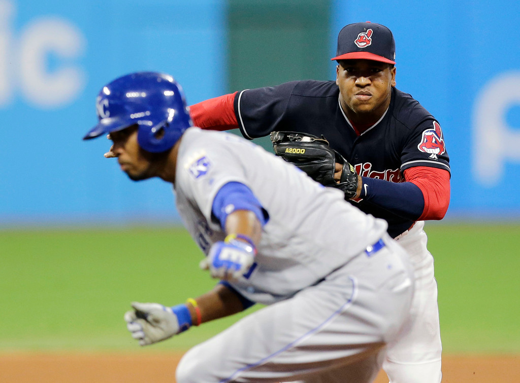 . Cleveland Indians\' Jose Ramirez, back, chases down Kansas City Royals\' Alcides Escobar in the seventh inning of a baseball game, Friday, May 26, 2017, in Cleveland. Escobar was out on the play. (AP Photo/Tony Dejak)