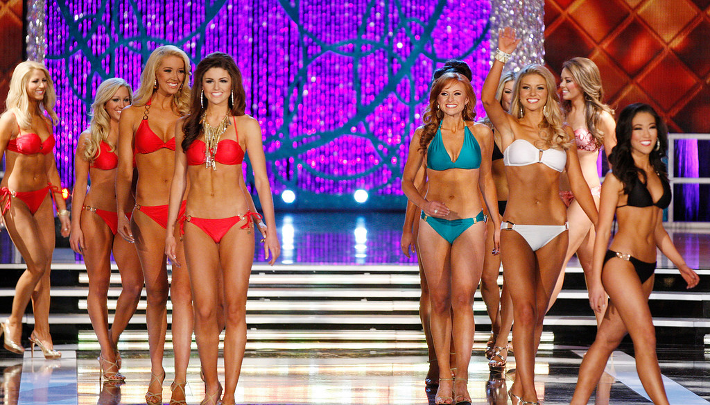 . Contestants compete in the swimsuit portion of the Miss America 2013 pageant on Saturday, Jan. 12, 2013, in Las Vegas. (AP Photo/Isaac Brekken)