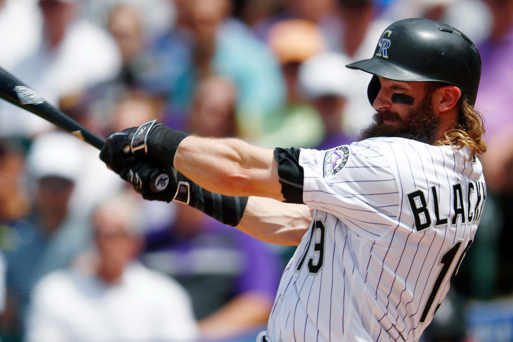 . Colorado Rockies\' Charlie Blackmon follows through on a two-run double off Cleveland Indians starting pitcher Trevor Bauer during the fourth inning of a baseball game Wednesday, June 7, 2017, in Denver. Colorado won 8-1. (AP Photo/David Zalubowski)