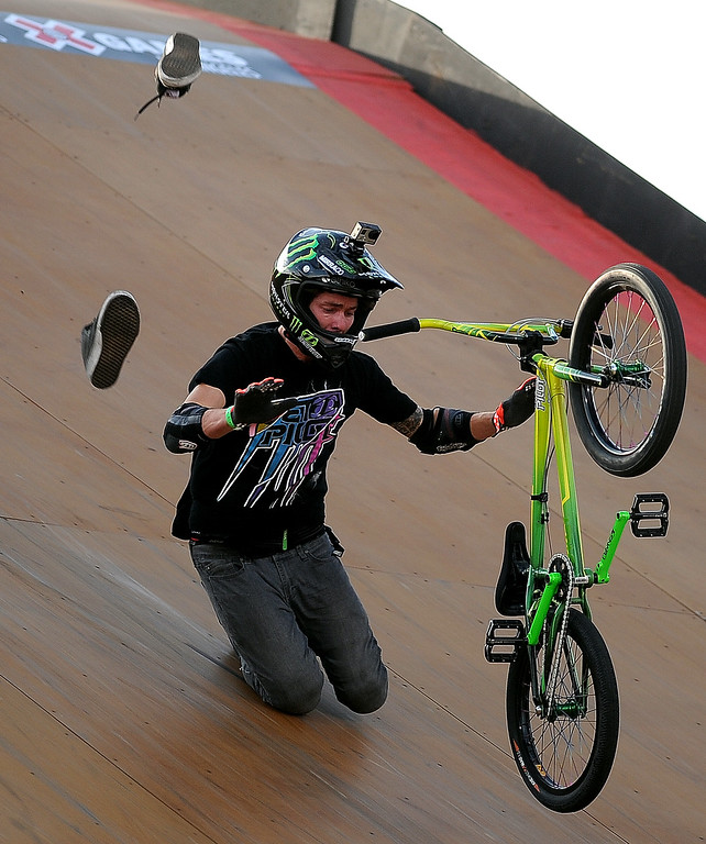 . Andy Buckworth loses his shoes as he crashes during the GoPro BMX Big Air Final at Irwindale Speedway on Friday, Aug. 2, 2013 in Irwindale, Calif. Morgan Wade won the gold medal.  (Keith Birmingham/Pasadena Star-News)