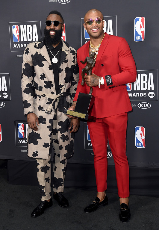 . NBA player James Harden, of the Houston Rockets, left, winner of the most valuable player award, poses in the press room with his teammate P.J. Tucker at the NBA Awards on Monday, June 25, 2018, at the Barker Hangar in Santa Monica, Calif. (Photo by Richard Shotwell/Invision/AP)