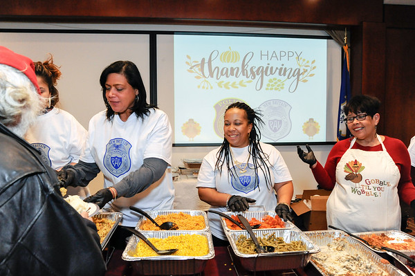 11/22/18 Wesley Bunnell | Staff The New Britain Police Department with the help of several area businesses and efforts from their stuff a cruiser events held a Thanksgiving Dinner at police headquarters. Several department members helped cook for the dinner. Lillian Watford, L, Marsha Michaud and Ruth Vazquez-Centeno help serve dinners.