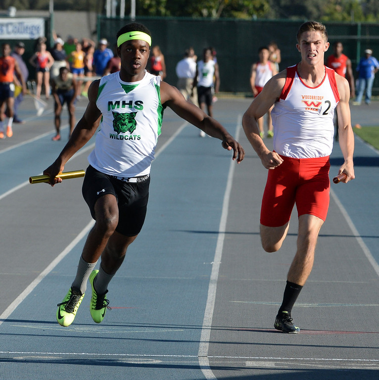 . Monrovia\'s Cravon Gillespie, left, runs the final leg of the 4x100 race during the CIF-SS Masters Track and Field meet at Falcon Field on the campus of Cerritos College in Norwalk, Calif., on Friday, May 30, 2014.   (Keith Birmingham/Pasadena Star-News)