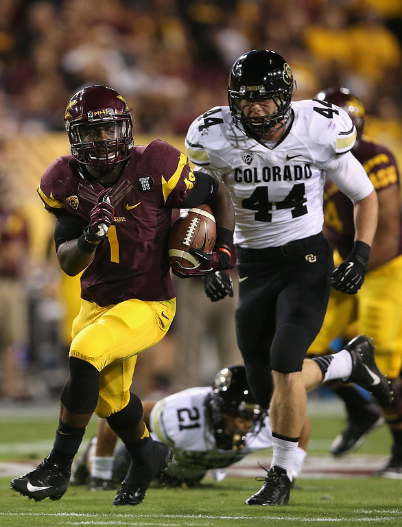 . TEMPE, AZ - OCTOBER 12:  Running back Marion Grice #1 of the Arizona State Sun Devils rushes the football past linebacker Addison Gillam #44 of the Colorado Buffaloes during the first quarter of the college football game at Sun Devil Stadium on October 12, 2013 in Tempe, Arizona.  (Photo by Christian Petersen/Getty Images)