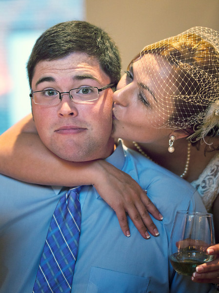Jesse gets a kiss from the bride.jpg