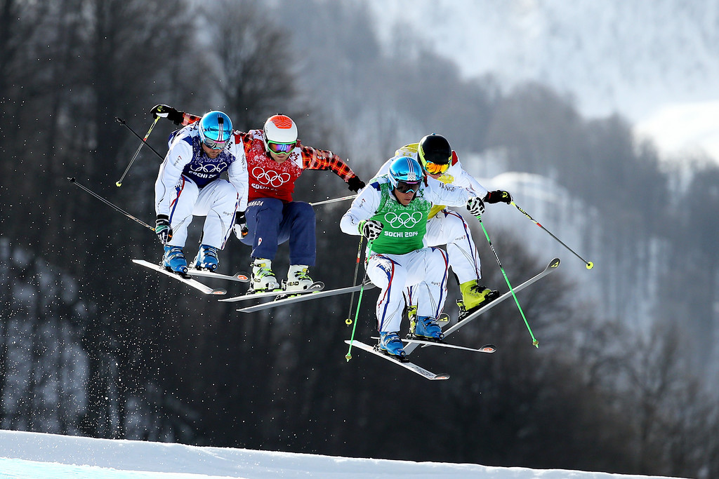 . Gold medallist Jean Frederic Chapuis (green top) of France leads from silver medallist Arnaud Bovolenta of France (blue top), Brady Leman (red top) of Canada and bronze medallist Jonathan Midol (R) of France during the Freestyle Skiing Men\'s Ski Cross Big Final on day 13 of the 2014 Sochi Winter Olympic at Rosa Khutor Extreme Park on February 20, 2014 in Sochi, Russia.  (Photo by Al Bello/Getty Images)