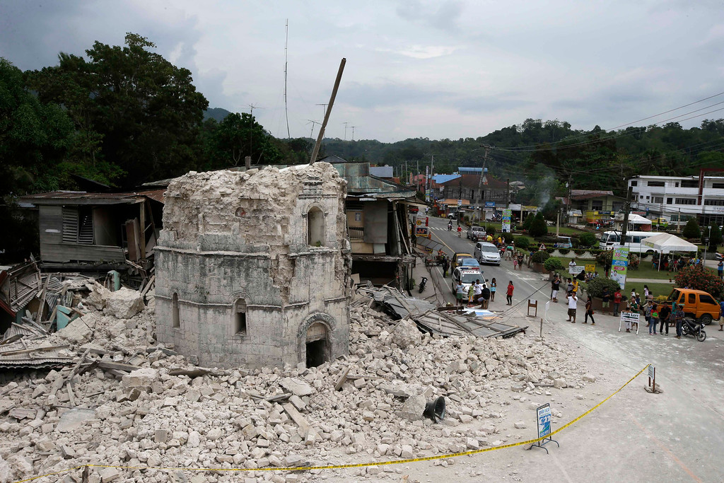 . The rubble from the toppled bell tower of Saint Peter church is scattered at an intersection at Loboc township, Bohol province in central Philippines Wednesday Oct. 16, 2013, a day after a 7.2-magnitude quake hit Bohol and Cebu provinces. (AP Photo/Bullit Marquez)