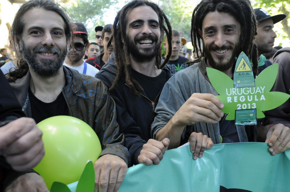 . Three men participate during the so called \'Last march of the illegal marijuana\' summoned by the groups that have long stood for the legalization of marijuana in the streets of Montevideo, Uruguay, 10 December 2013. The march goes up to the Legislative Palace where the Senate is discussing the law that legalizes the production and sale of marijuana in Uruguay that will face final approval today.  EPA/Sandro Pereyra