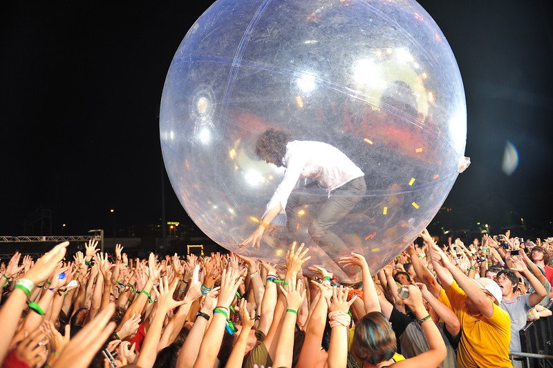 Flaming Lips frontman, Wayne Coyne, rolls around the crowd inside this huge ball.